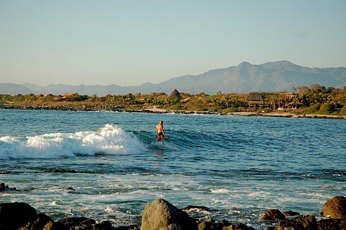 Surfer in Troncones Bay