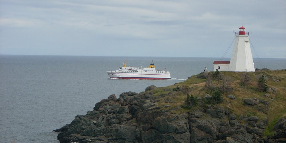 Ferry & Swallowtail Lighthouse at North Head