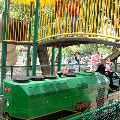The engine of the Zilker Zephyr passes under the playscape in Zilker Park in Austin