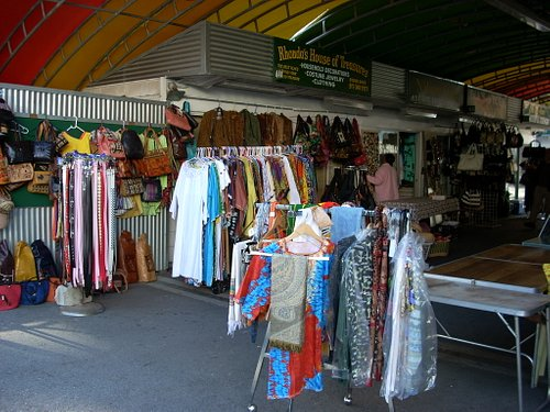 An African Market stall with clothing .