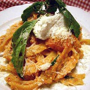 home pasta with ragu sauce and ricotta