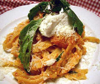 home pasta with ragu sauce and ricotta