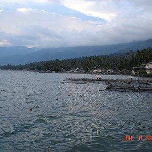 Fish farms dotting the shoreline, Maninjau