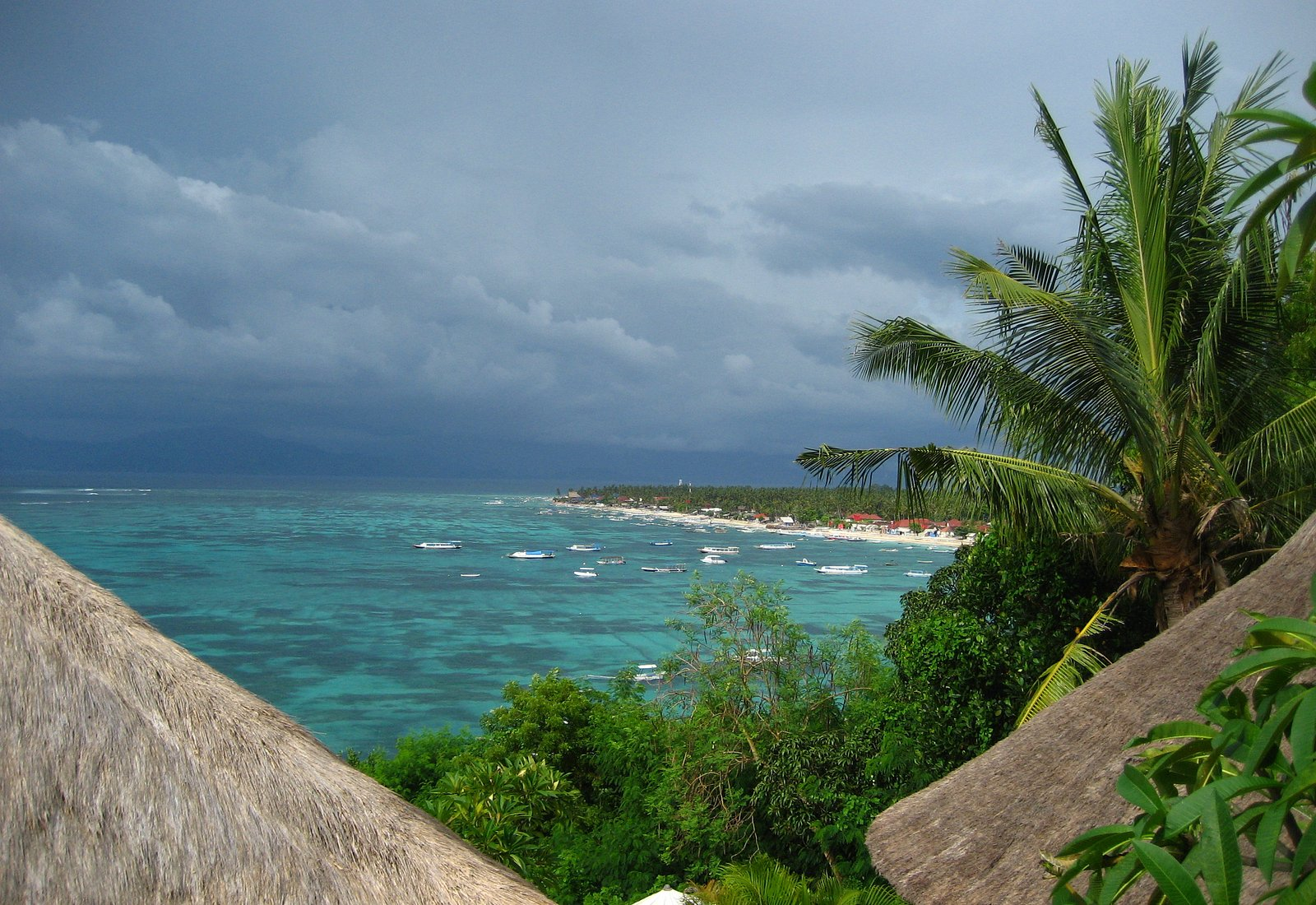 A view over the seaweed fields of Lembongan.  Bali on the horizon