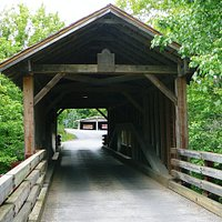 End view of Harrisburg Covered Bridge with marker