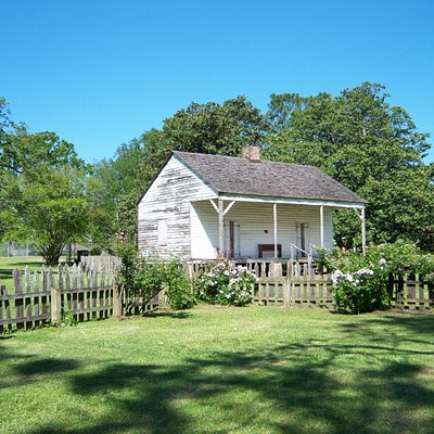 one of the several buildings behind the plantation home