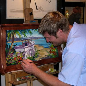 Steve Barton painting at a show