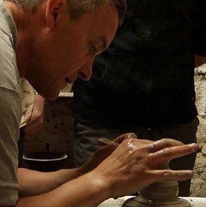 Adrian demonstrates throwing on the potter's wheel