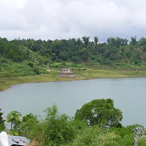 rim of the lake/crater is lined with ancient rice paddies