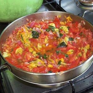 Zucchini ravioli in tomato/zucchini flower sauce