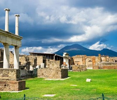 View into the Pompeii Ruins, with Mount Vesuvius looming in the distance