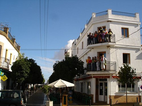 School building in the centre of Prado del Rey with students on the balconies