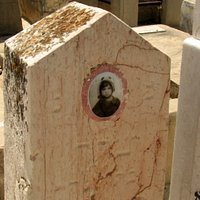 Some old tomb stones carry a photo of the deceased
