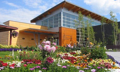 Morris Thompson Cultural & Visitors Center with historic cabin and garden out front.