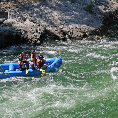 A calmer portion of the whitewater rafting trip where people will occasionally choose to take a
