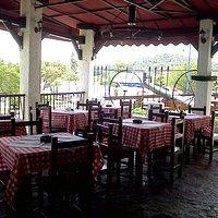 Taberna Mediterranea Bar Restaurant - Outdoor Terrace overlooking the Malecon and Marina in Sama