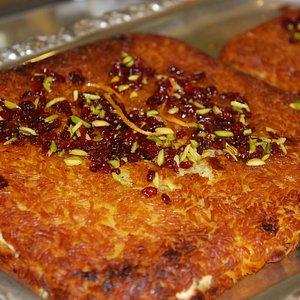 Tahchin! a unique crusty rice with saffron, barberries, yogurt, chicken and pistachio.