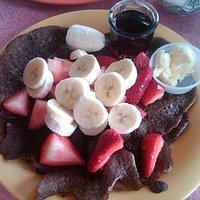 Thin buckwheat pancake with fresh fruit