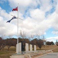 Under Australian and Merchant Navy flags