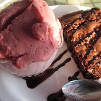 Brownie with wild berry gelato