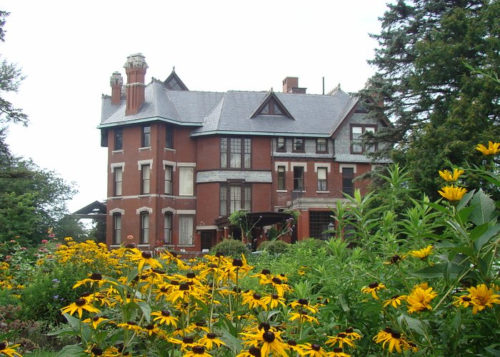 The Queen Anne style mansion sits on a 26-acre estate with formal gardens, woods, an orchard, an