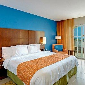 We offer spacious guestrooms at Courtyard by Marriott Barbados, Barbados.