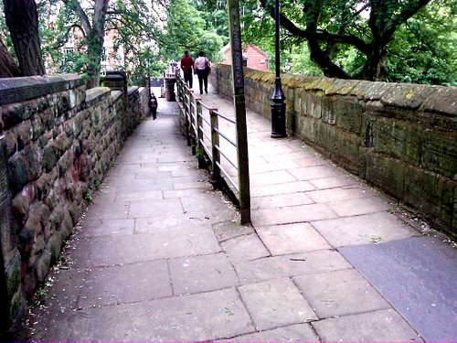 Atop the wall, an access ramp from Chester Cathedral at left