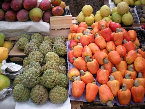 fruta de conde (left), cashews on right