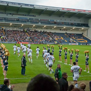 Cheerleaders greeting the players onto the pitch