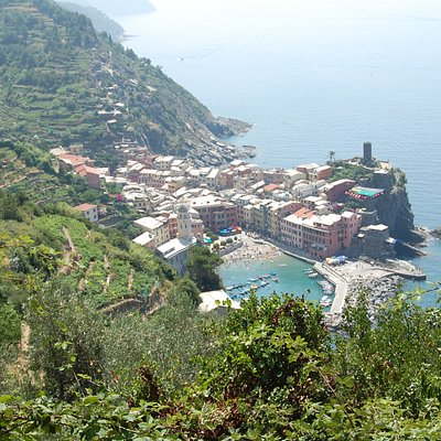 the first glimpse of vernazza on the trail from monterosso al mare