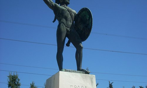 The bronze statue of Leonidas portrays him with raised spear and shield.