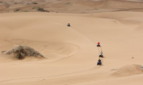 Ouad bikes in the dunes
