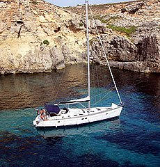 Relaxing in the secluded Crystal Lagoon, Comino