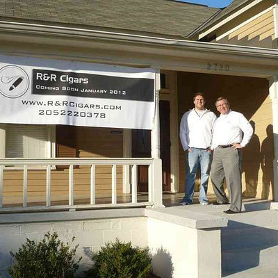 The Owners outside the brand new R&R Cigars