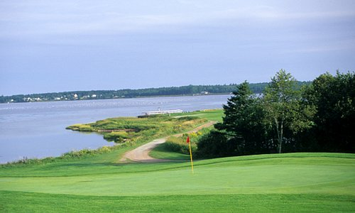 The rolling Number 15 Green and Number 16 Tee set against a vista of Covehead Bay.