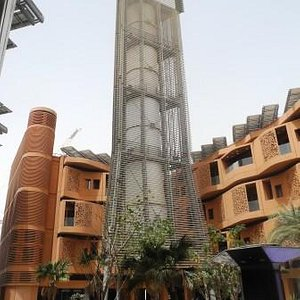 This is a wind tower that cools the entire plaza it sits in, with no electricity, just wind.