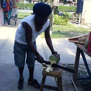 Roger chopping a coconut