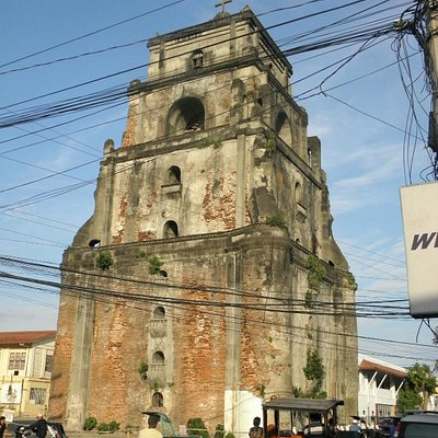the sinking bell tower amidst the electric cables