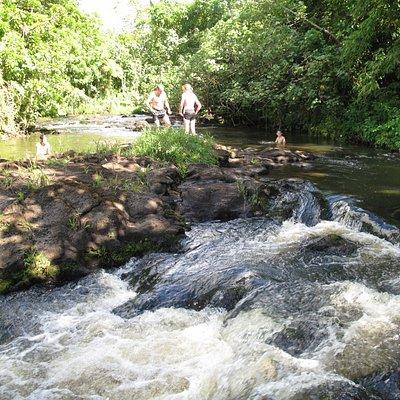 swimming at the top of fuipisia waterfall