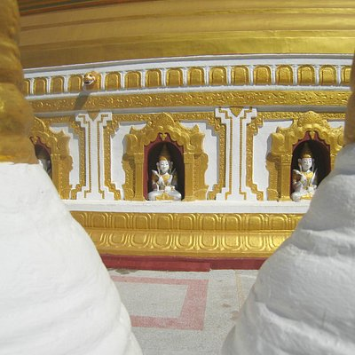 Some of the 120 nat and deva images around the stupa