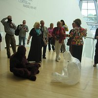 An informative Taubman docent with a group of visitors.