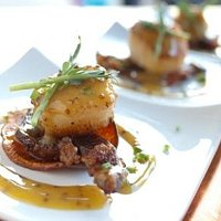 Scallops & Prime Rib Bacon with a Sweet Potato Chip and Truffle honey Mustard sauce.