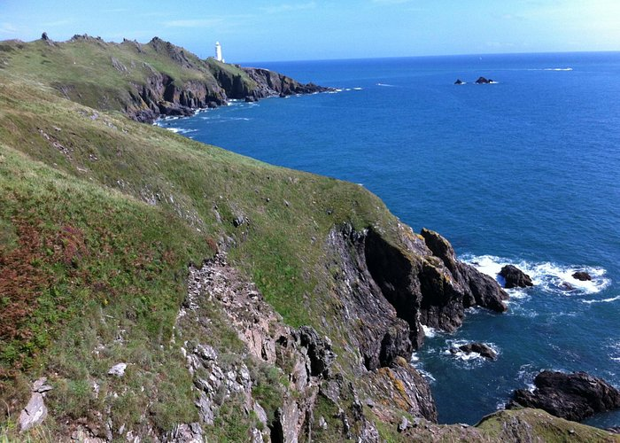 view from the coastpath back to the lighthouse