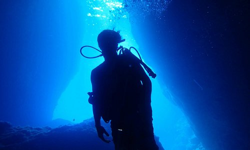 Diver silhouetted in hole #3 at the Grotto.