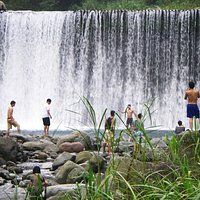 The falling curtain of water attracts those with courage, others enjoy it from safe distance