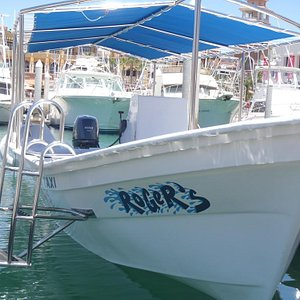Our boat at the dock, ready to take you on an adventure!