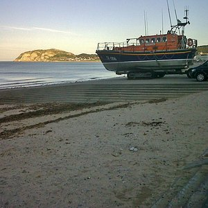 Llandudno lifeboat on display on the North Shore, Little Orme in the background