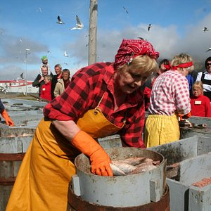 A local herring girl gutting and salting. Demonstrations are held each Saturday in July at 15:00