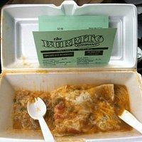 A delicious half-eaten breakfast burrito.