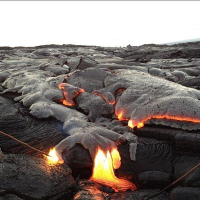 Hawaii volcanoe lava tour. Guests poking the lava with a stick!